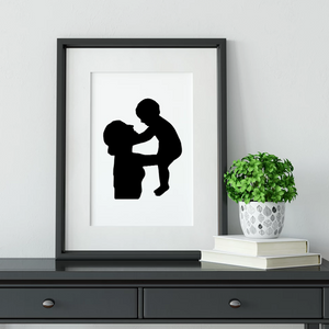framed silhouette of mum and baby on dresser
