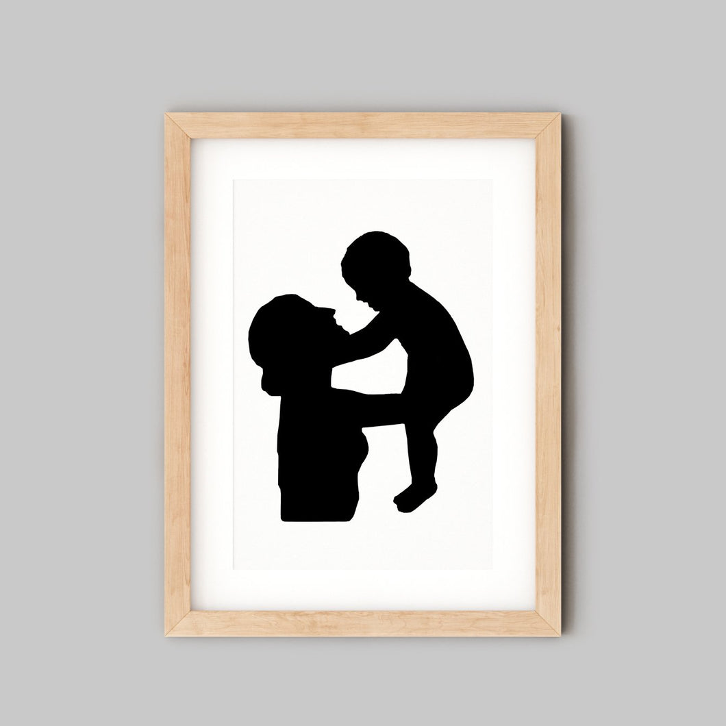 silhouette of mum and baby in wooden frame