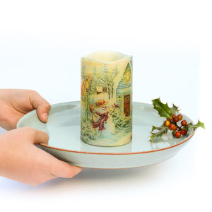 hands holding Christmas Window Decor - Christmas Snowman Scene LED Candle  - the sage haven, ireland