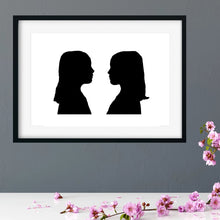 Load image into Gallery viewer, framed side profile silhouette of twin girls
