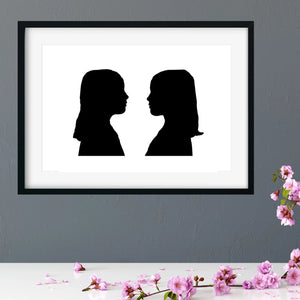 framed side profile silhouette of twin girls