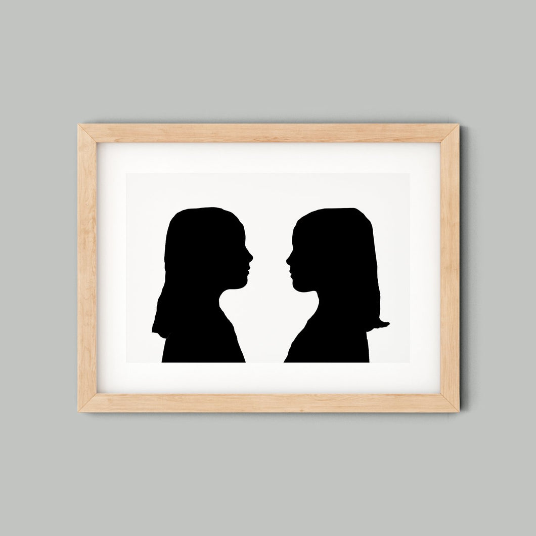 framed silhouette of twin girls