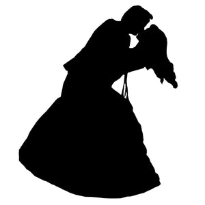 silhouette of couple dancing at wedding