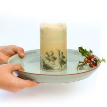 Load image into Gallery viewer, hands holding flameless candle on plate