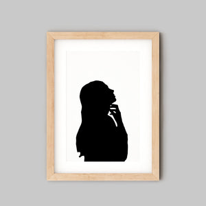 silhouette of woman in wooden frame
