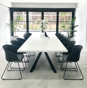 Stunning 3000mm table in white with black architecturally designed feature legs