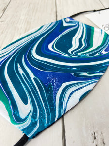Waves of teal, royal blue and white marbled mask/face covering