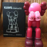 kaws passing through open edition model made from vinyl