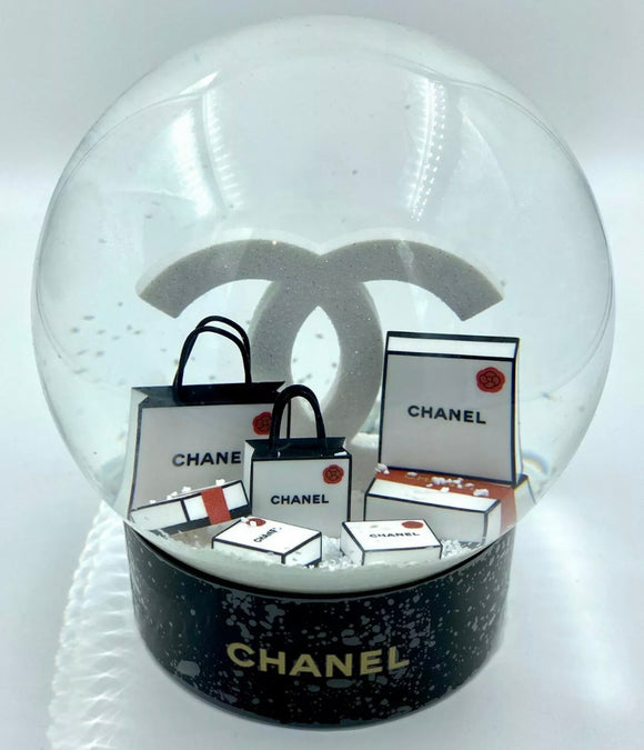 CHANEL VIP CHRISTMAS GIFT SNOW GLOBE, WHICH IS CONSIDERED AS THE MOST BEAUTIFUL SNOW GLOBE CHANEL EVER OFFERED.