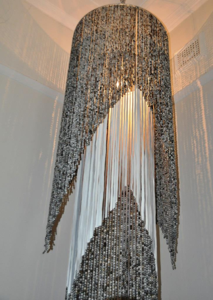 African mama chandelier. white pearl resort