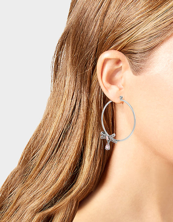 GET YOUR WINGS BOW HOOP EARRINGS BLUSH - JEWELRY - Betsey Johnson