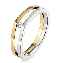 Modern and contemporary 18ct yellow gold and silver raindrop ring set with a round brilliant cut diamond