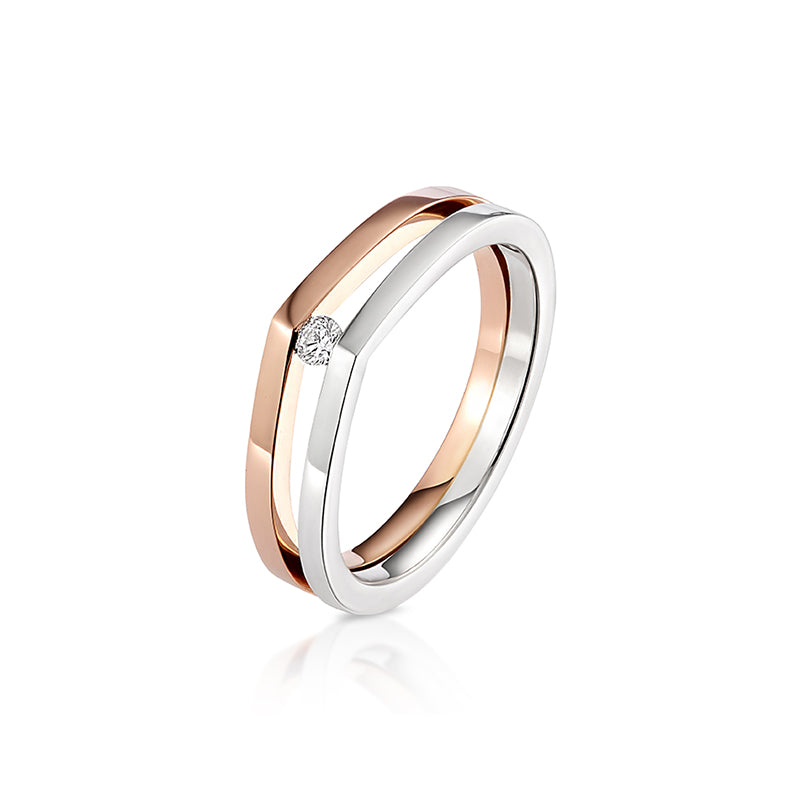 Modern and contemporary 18ct rose gold and silver raindrop ring set with a round brilliant cut diamond