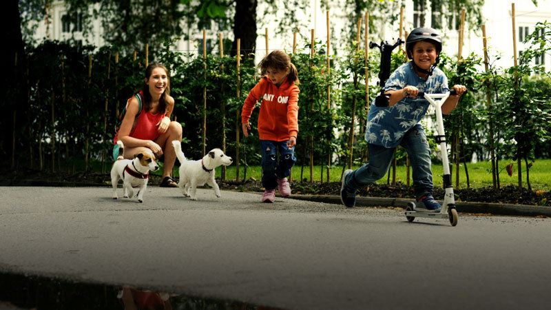 Kids and dogs running along side Wiral LITE
