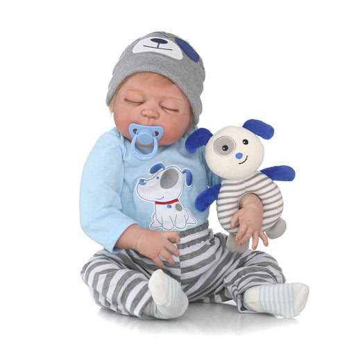 "22"" Carefree Lifelike Boy Doll with Closed Eyes"
