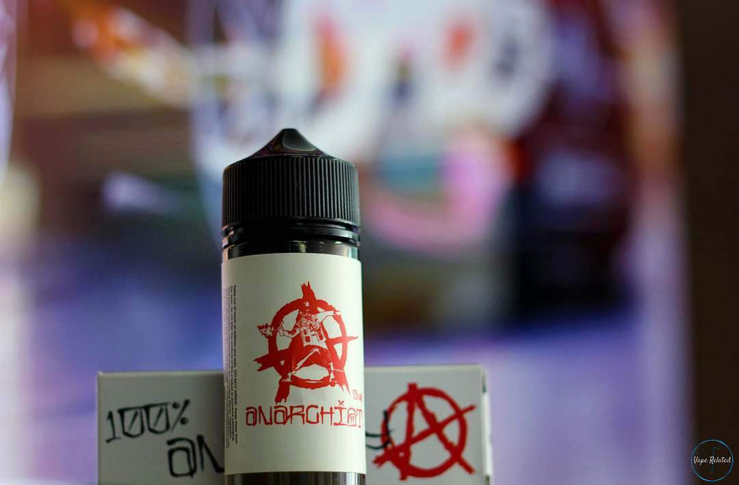 White Anarchist Vape E juice standing in front of Vape Related image.