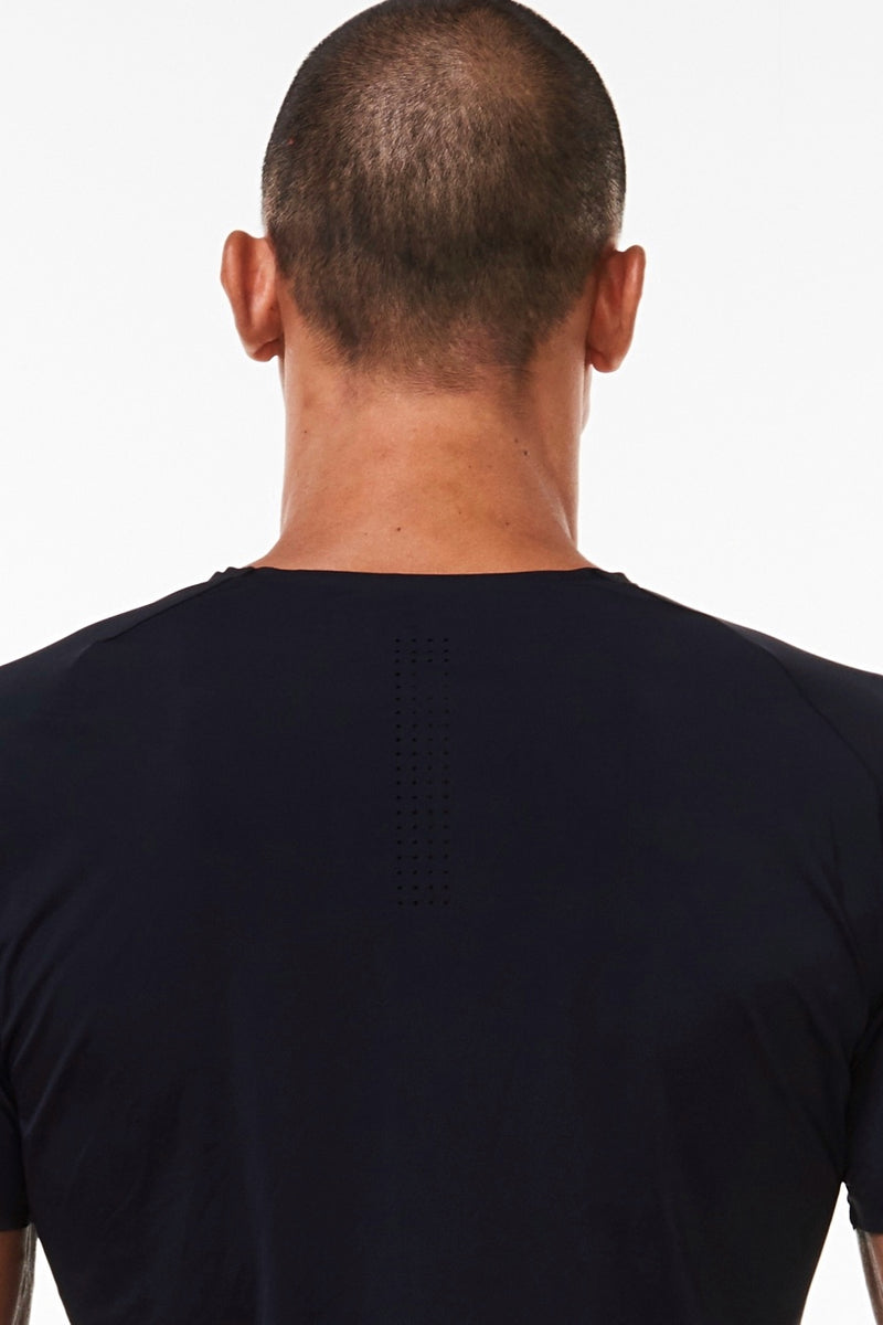 Upper back view of Men's Edge Performance Tee. Workout tee with holes for ventilation.