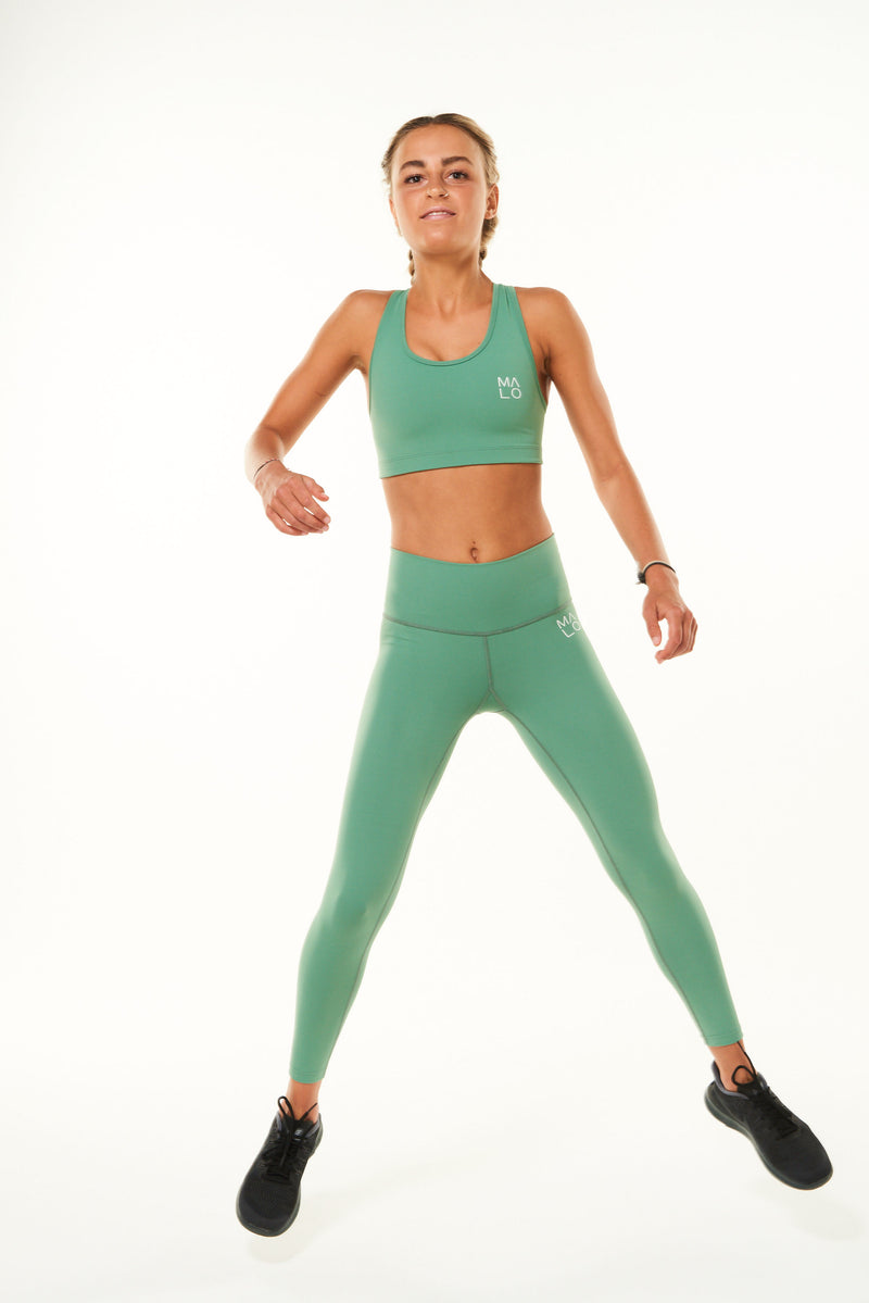 Model wearing Sagebrush 7/8 leggings with black singlet. Workout leggings for any activity.