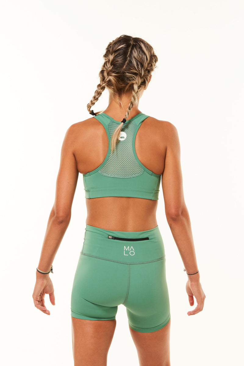Back view Racergril bra. Green sports bra with mesh panel for ventilation to keep you cool in workouts.