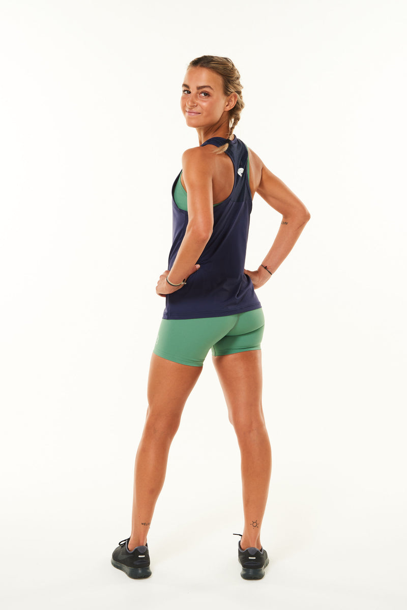Modeling back of Endure Tank. Women's navy running singlet.