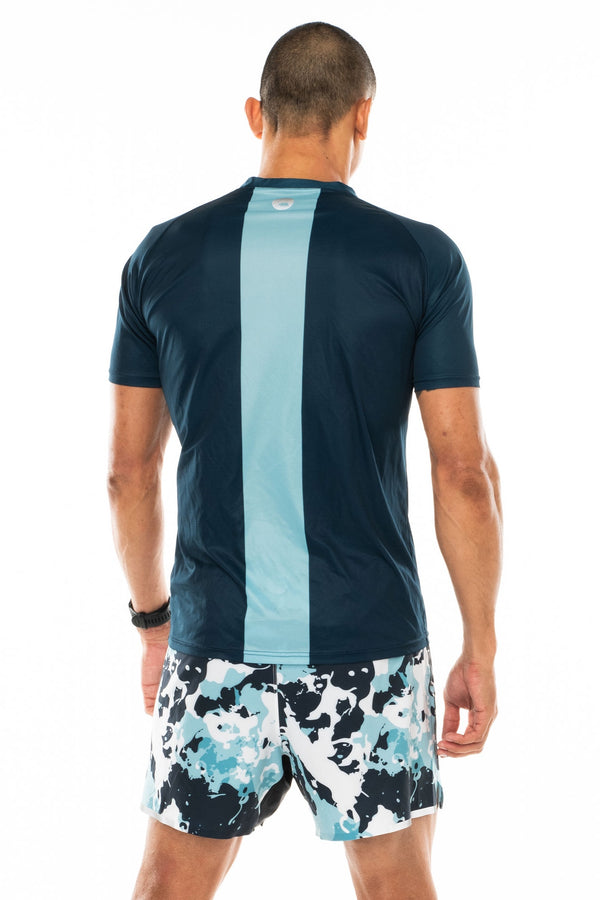 Back view men's blue short sleeve workout shirt. Lightweight running shirt with reflective logo and vertical light blue stripe.