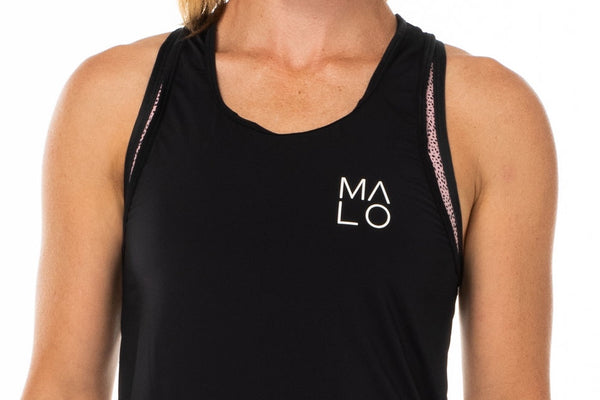 Close view Black Endure Tank. Sleeveless top with white logo on left side.