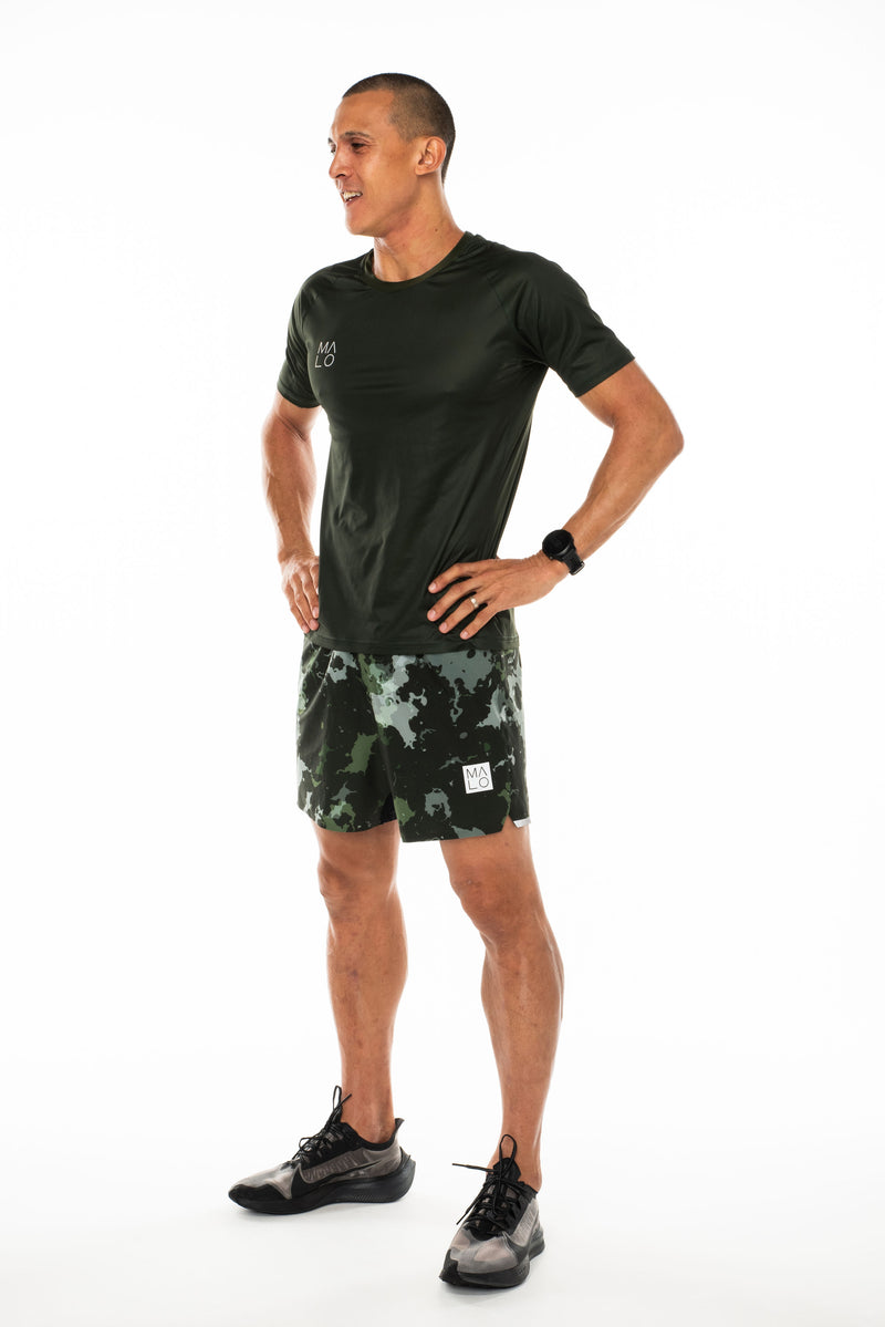 Left view men's green performance tee. Lightweight and moisture-wicking running and workout t-shirt.