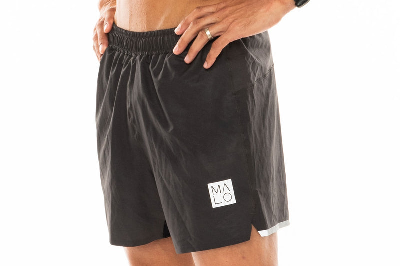 Left view men's Noosa Run Short. Mid-thigh gray run shorts for workout and leisure.