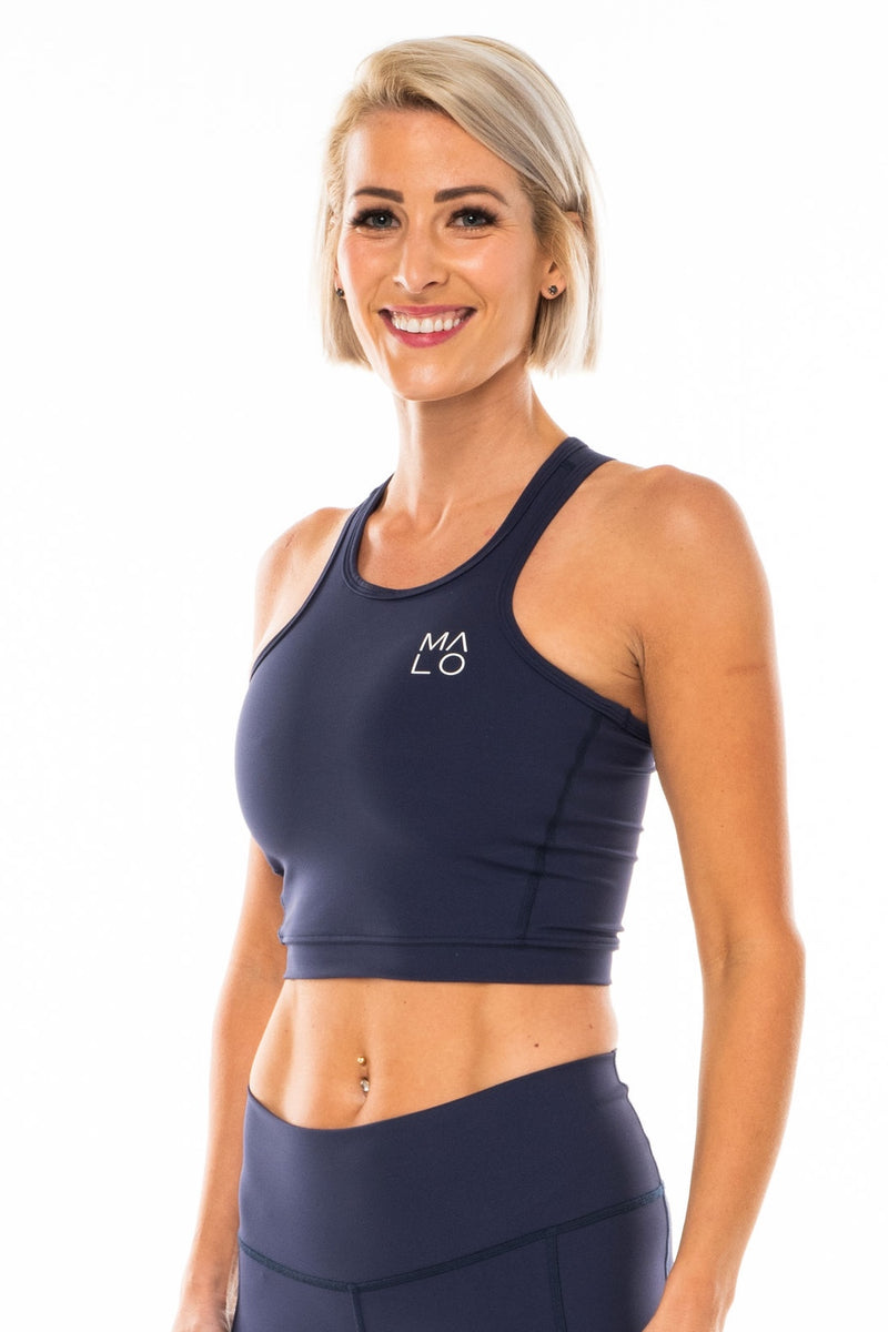 Navy Core Crop. Women's blue form-fitting tank top for workout or casual wear.