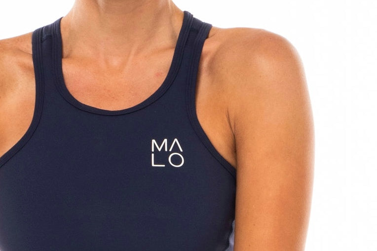 Close view women's Core Crop. Navy crop top with white 'MALO' logo on left chest.