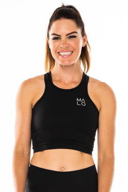 Black Core Crop. Women's black form-fitting tank top for workout or casual wear.