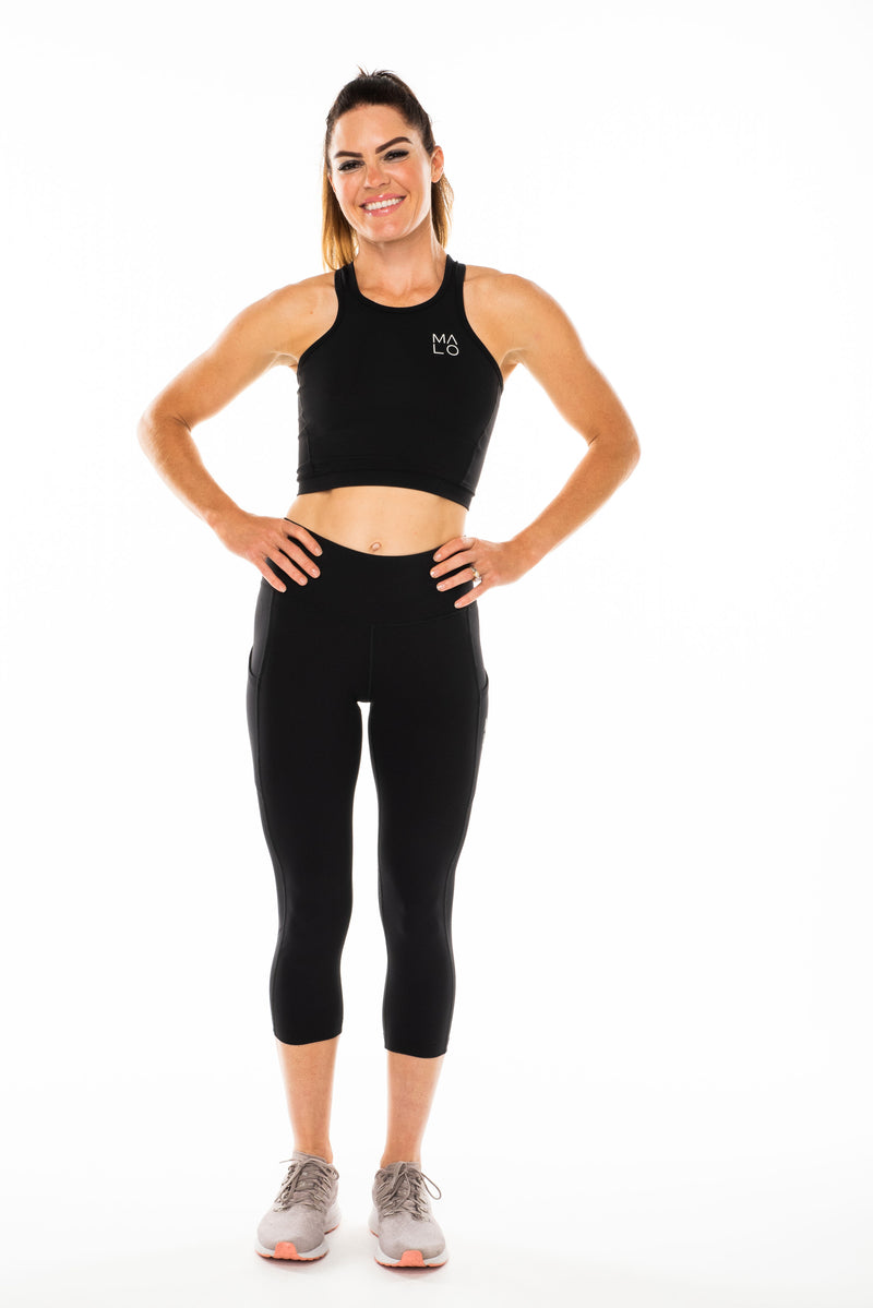 Women's Core Crop.  Black sleeveless technical top for workouts and athleisure.
