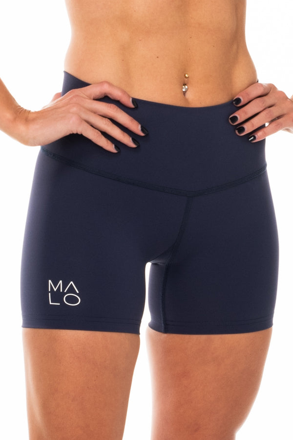 Navy athleisure shorts. Mid-thigh running shorts that are quick drying and breathable.