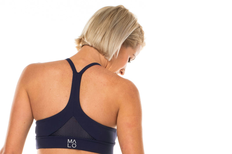 Back view Navy Sunshine Bra. Breathable sports bra with mesh panel.