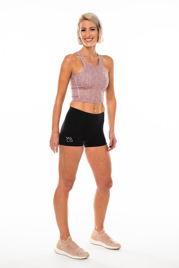 Women's Core Crop. Pink technical top for workouts and athleisure.