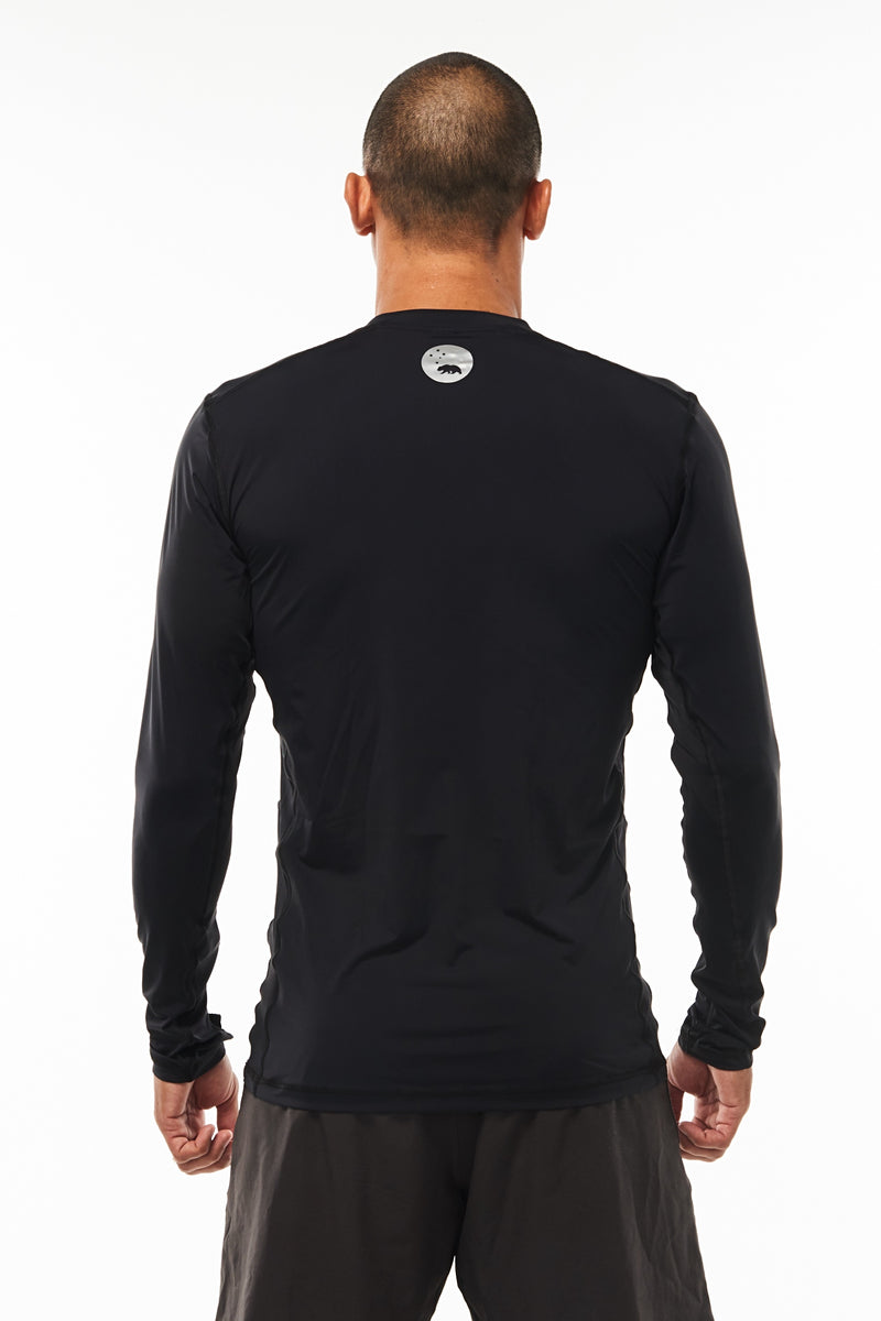 Back view Endure Long Sleeve. Men's black running shirt. Reflective logo for safety.