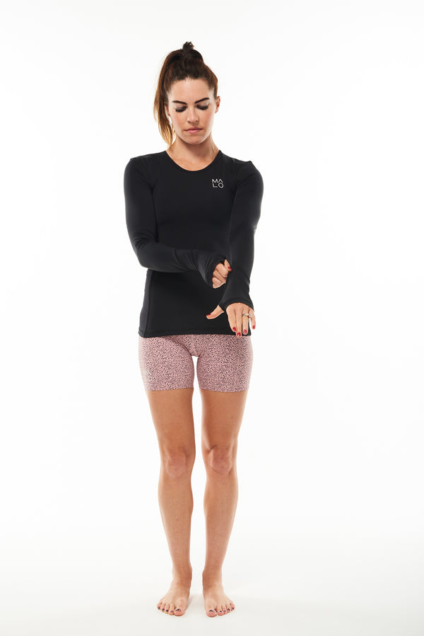 Women's long sleeve running shirt. Performance tee with thumbholes to keep in warmth.