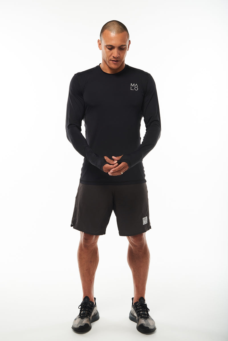 Men's long sleeve running shirt. Performance tee with thumbholes to keep in warmth.