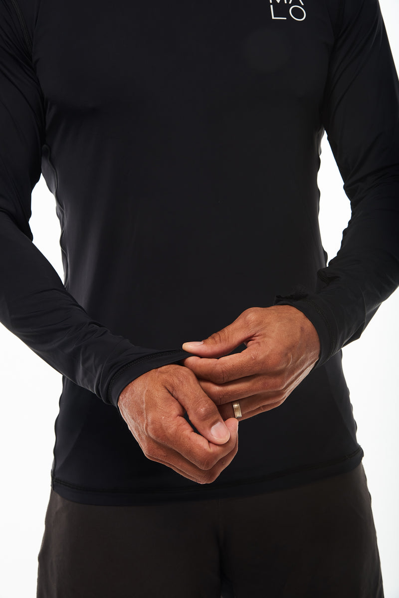 Close view Endure Long Sleeve black shirt. Men's long sleeve workout shirt. Lightweight breathable fabric.