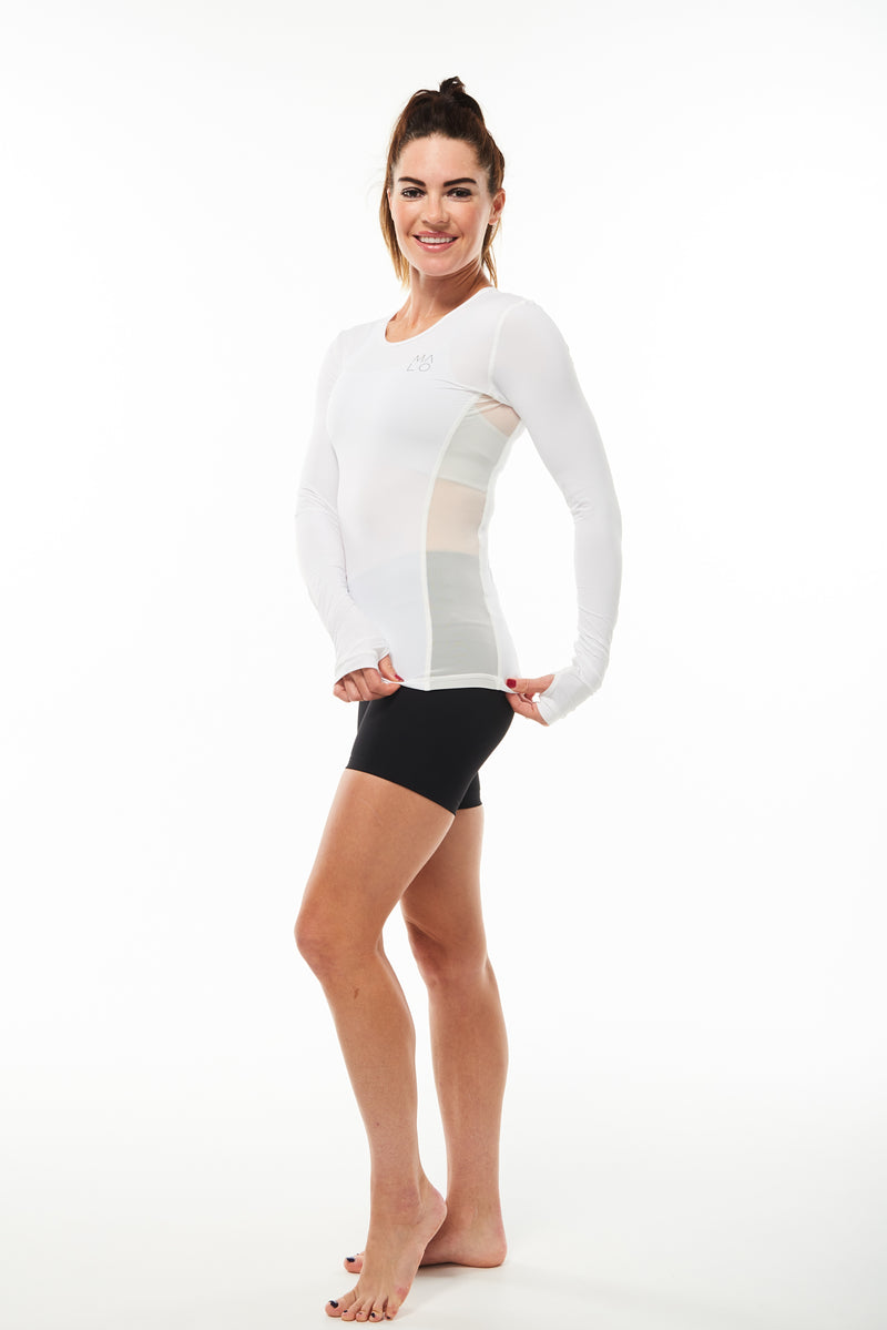 Model showing mesh side panels in long sleeve shirt for ventilation. Black breathable workout shirt.