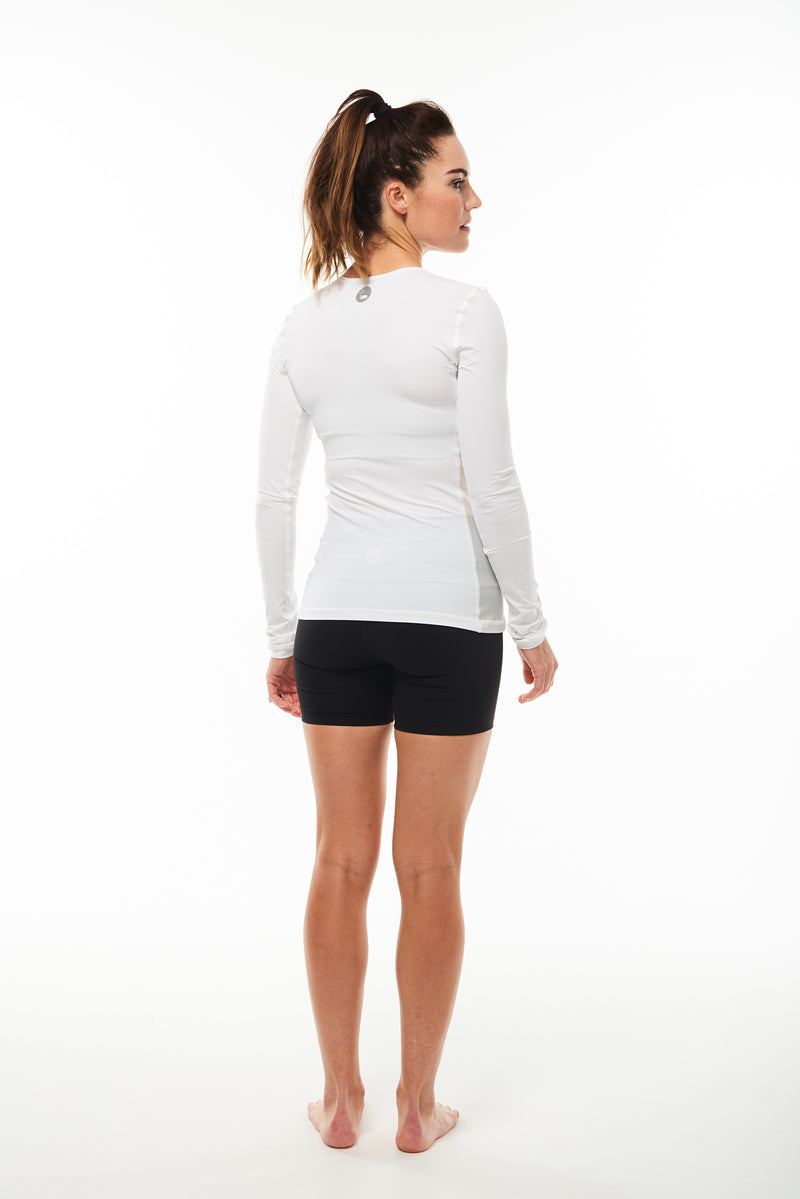 Back view Endure Long Sleeve. Women's white running shirt. Reflective logo for safety.