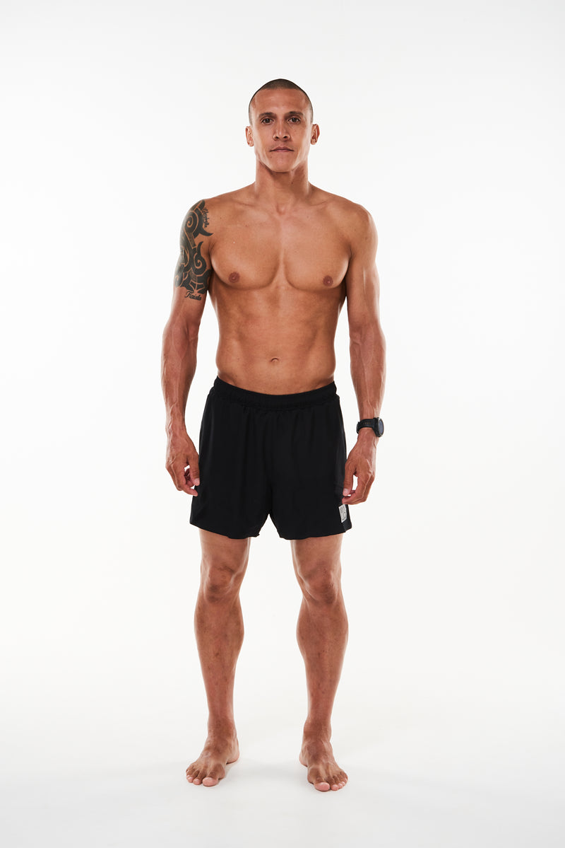 Men's Black Noosa Run Short. Black run shorts with mesh liner. Running shorts with 5.5 inseam.