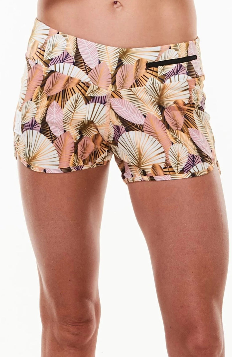 Women's Run The World Shorts. Gold leaf print relaxed fit running and workout shorts. White logo on right leg.