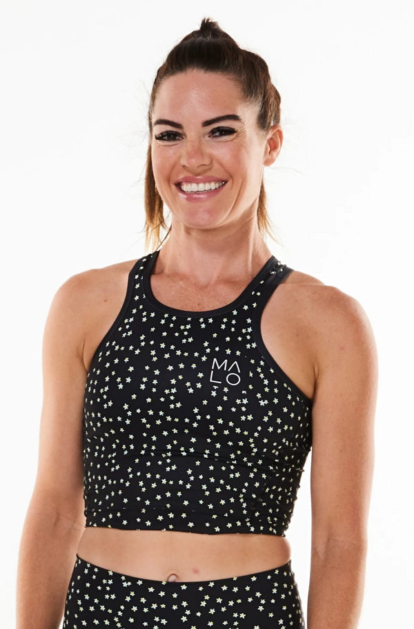 Black Bloom Core Crop. Women's black form-fitting tank top for workout or casual wear with daisy print.
