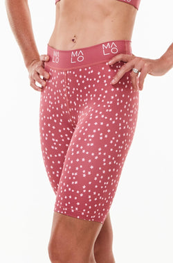 Left view Nantucket Bloom Pedal Pumpers. Longer shorts with light compression. Pink workout shorts that go to the knee.
