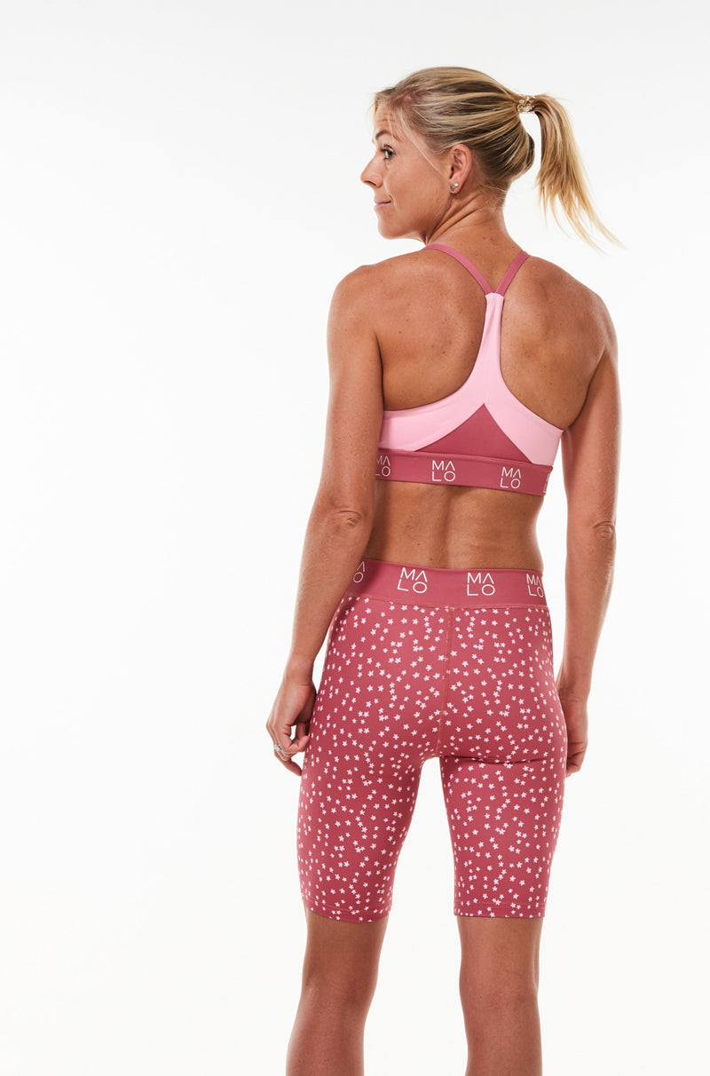 Back view Nantucket Pink Sunshine Bra. Pink sports bra with light pink panels.