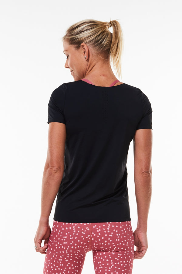 Back view Women's Edge Performance Tee. Black sweat-wicking T-shirt with mid-hip hemline.