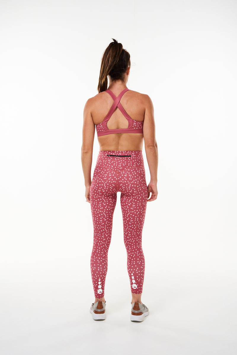 Back view Pacer 7/8 Leggings. Pink leggings with reflective logo. Long length yoga pants.