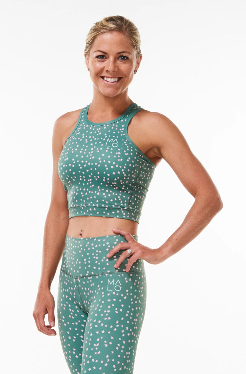 Sage Bloom Core Crop. Women's green form-fitting tank top for workout or casual wear with daisy print.