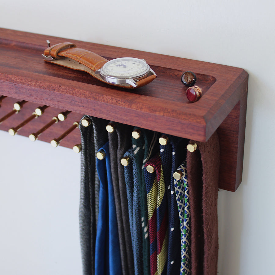 Custom Bubinga tie rack with shelf and brass pegs